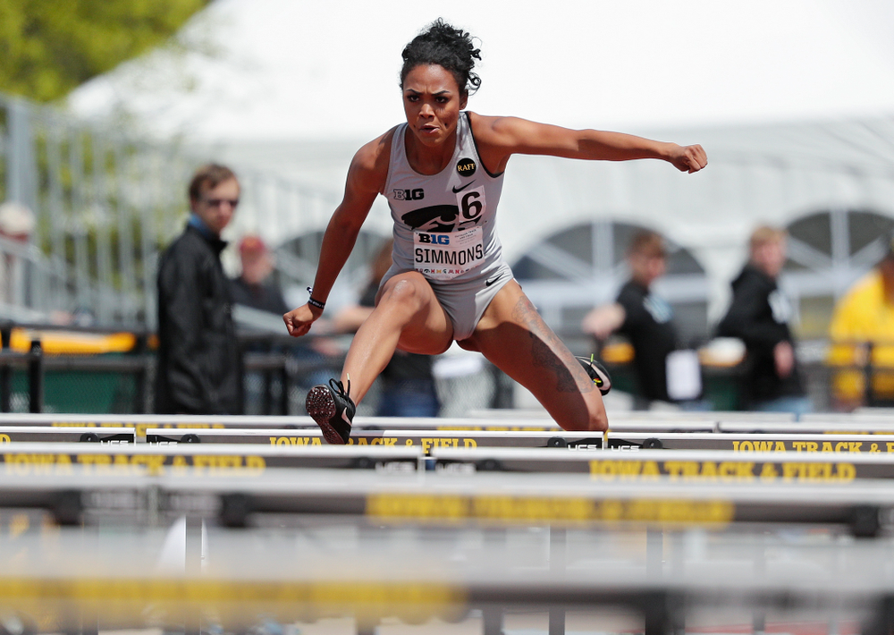 Iowa's Tria Simmons runs the 100 meter hurdles during the women's heptathlon event on the first day of the Big Ten Outdoor Track and Field Championships at Francis X. Cretzmeyer Track in Iowa City on Friday, May. 10, 2019. (Stephen Mally/hawkeyesports.com)