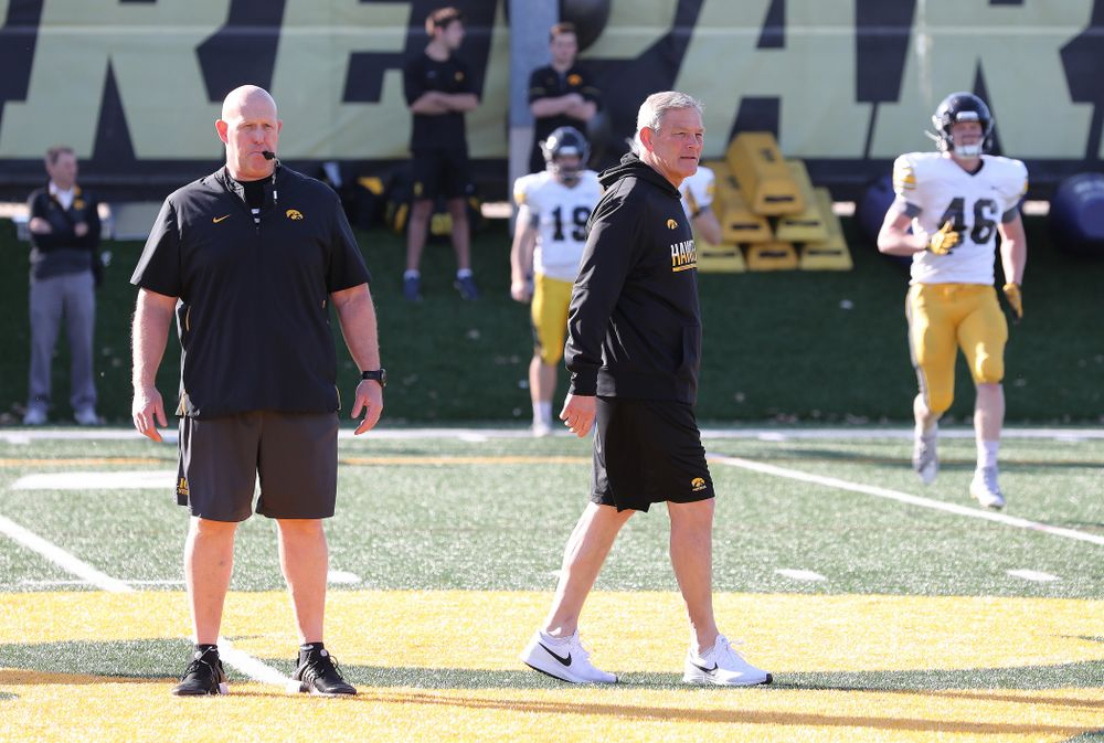 Iowa Hawkeyes head coach Kirk Ferentz and strength and conditioning coordinator Chris Doyle during the teamÕs final spring practice Friday, April 26, 2019 at the Kenyon Football Practice Facility. (Brian Ray/hawkeyesports.com)