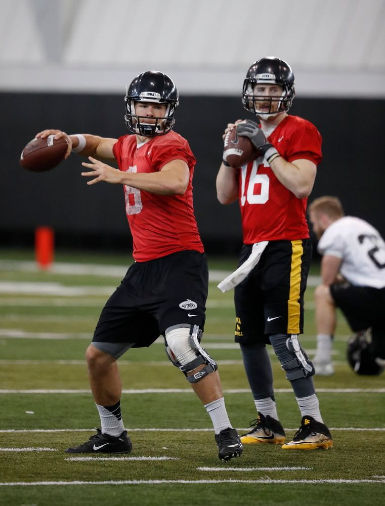 quarterback Tyler Wiegers (8) and quarterback C.J. Beathard (16)
