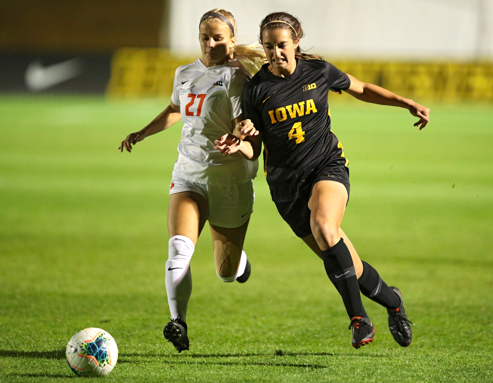Iowa forward Kaleigh Haus (4) battles for position on the ball during the first half of their match against Illinois at the Iowa Soccer Complex in Iowa City on Thursday, Sep 26, 2019. (Stephen Mally/hawkeyesports.com)