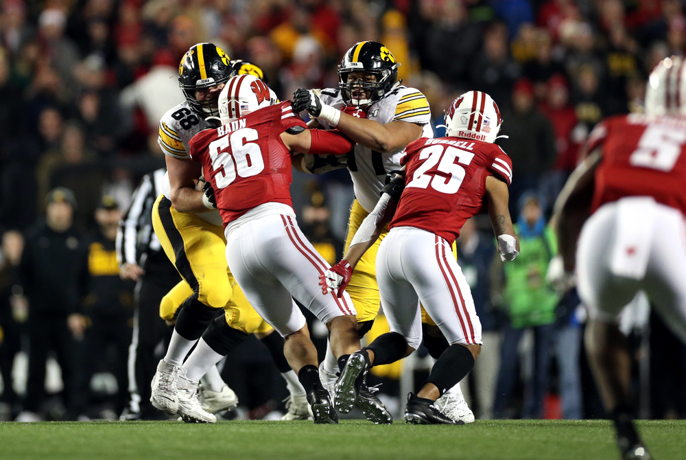 Iowa Hawkeyes offensive lineman Landan Paulsen (68) and offensive lineman Alaric Jackson (77) against the Wisconsin Badgers Saturday, November 9, 2019 at Camp Randall Stadium in Madison, Wisc. (Brian Ray/hawkeyesports.com)