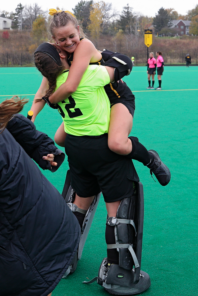 Iowa's Maddy Murphy (26) jumps into the arms of Grace McGuire (62) after winning their game at Grant Field in Iowa City on Saturday, Oct 26, 2019. (Stephen Mally/hawkeyesports.com)