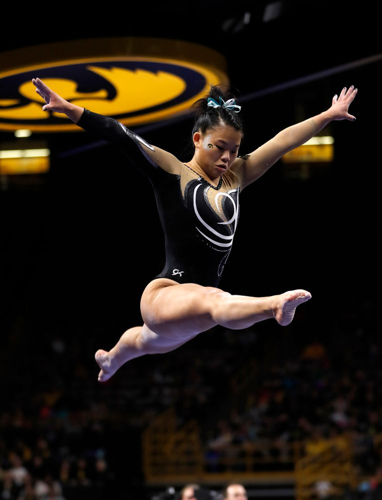 Iowa's Misty-Jade Carlson competes on the beam against the Nebraska Cornhuskers