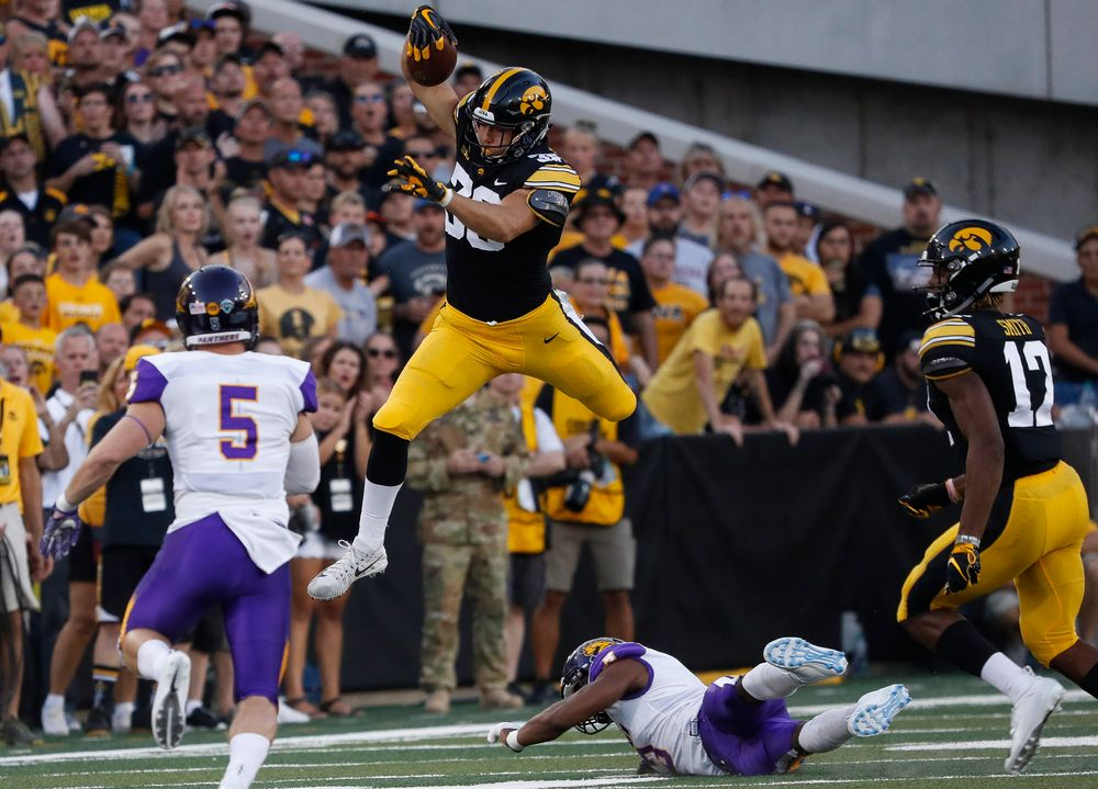 Iowa Hawkeyes tight end T.J. Hockenson (38) hurdles a defender during a game against Northern Iowa at Kinnick Stadium on September 15, 2018. (Tork Mason/hawkeyesports.com)