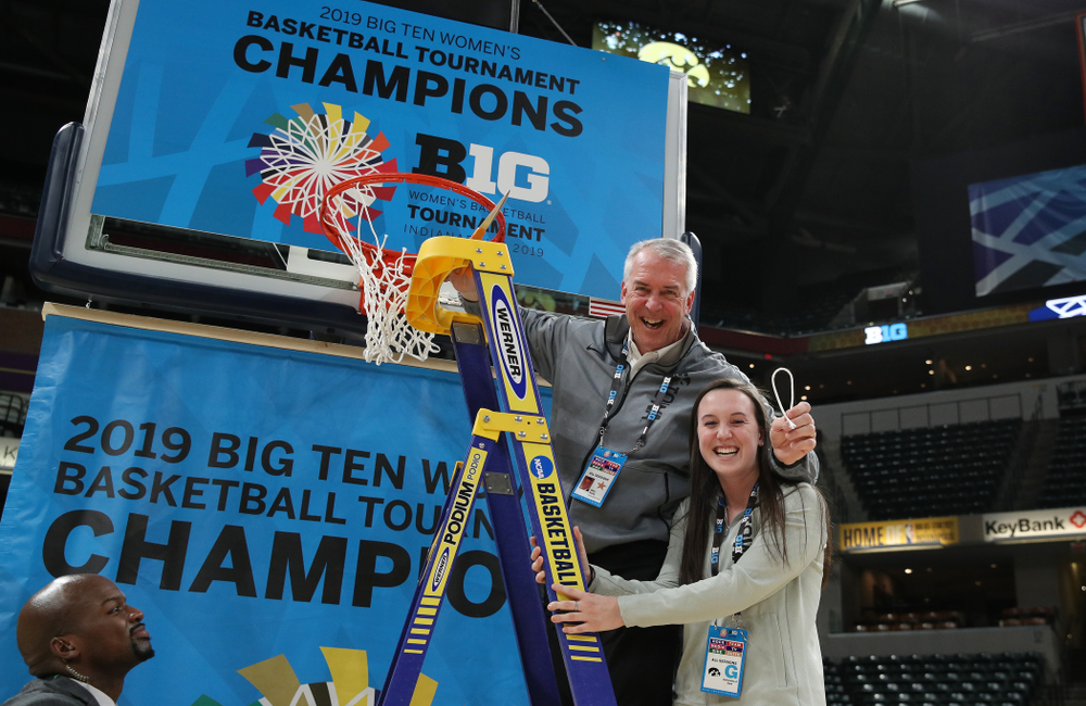 Athletics Director Gary Barta cuts down the net as they celebrate their victory over the Maryland Terrapins in the Big Ten Championship Game Sunday, March 10, 2019 at Bankers Life Fieldhouse in Indianapolis, Ind. (Brian Ray/hawkeyesports.com)