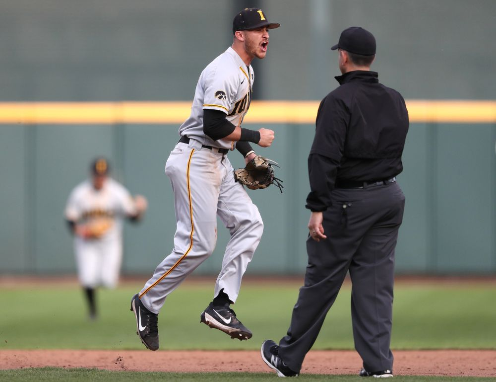 Iowa Hawkeyes Tanner Wetrich (16) celebrates after tuning a double play against the Indiana Hoosiers in the first round of the Big Ten Baseball Tournament Wednesday, May 22, 2019 at TD Ameritrade Park in Omaha, Neb. (Brian Ray/hawkeyesports.com)