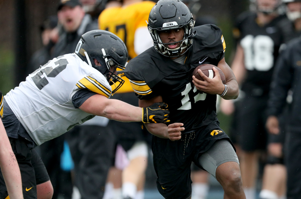 Iowa Hawkeyes running back Tyler Goodson (15) carries the ball during practice Monday, December 23, 2019 at Mesa College in San Diego. (Brian Ray/hawkeyesports.com)