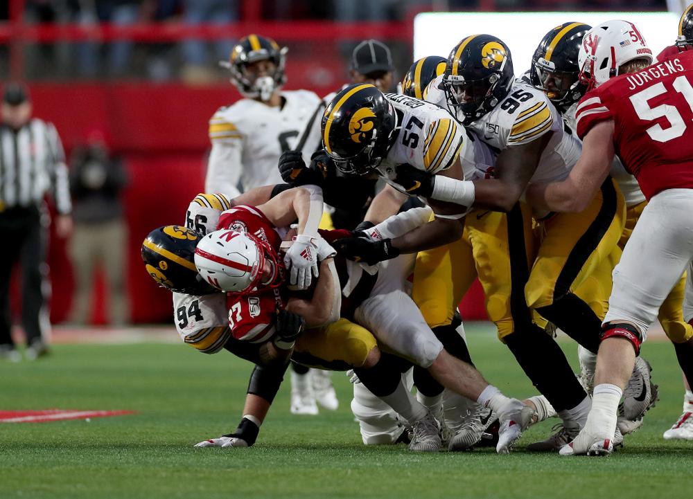 Iowa Hawkeyes defensive end A.J. Epenesa (94), defensive end Chauncey Golston (57), and defensive lineman Cedrick Lattimore (95) against the Nebraska Cornhuskers Friday, November 29, 2019 at Memorial Stadium in Lincoln, Neb. (Brian Ray/hawkeyesports.com)