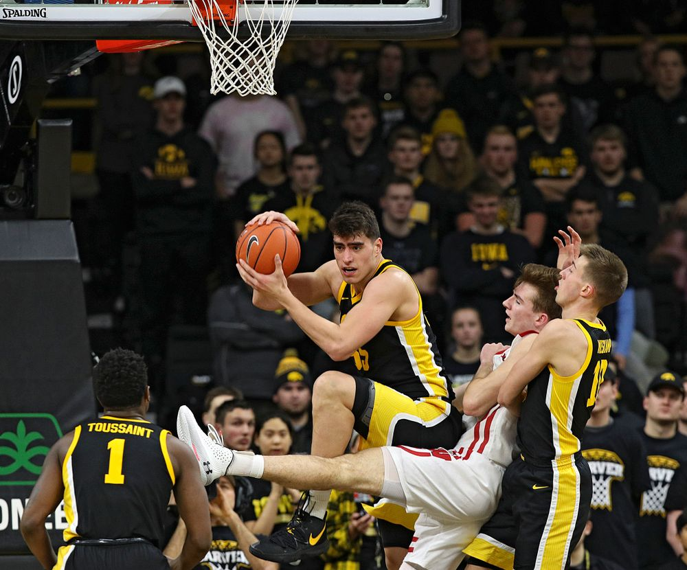 Iowa Hawkeyes center Luka Garza (55) pulls in a rebound during the second half of their game at Carver-Hawkeye Arena in Iowa City on Monday, January 27, 2020. (Stephen Mally/hawkeyesports.com)