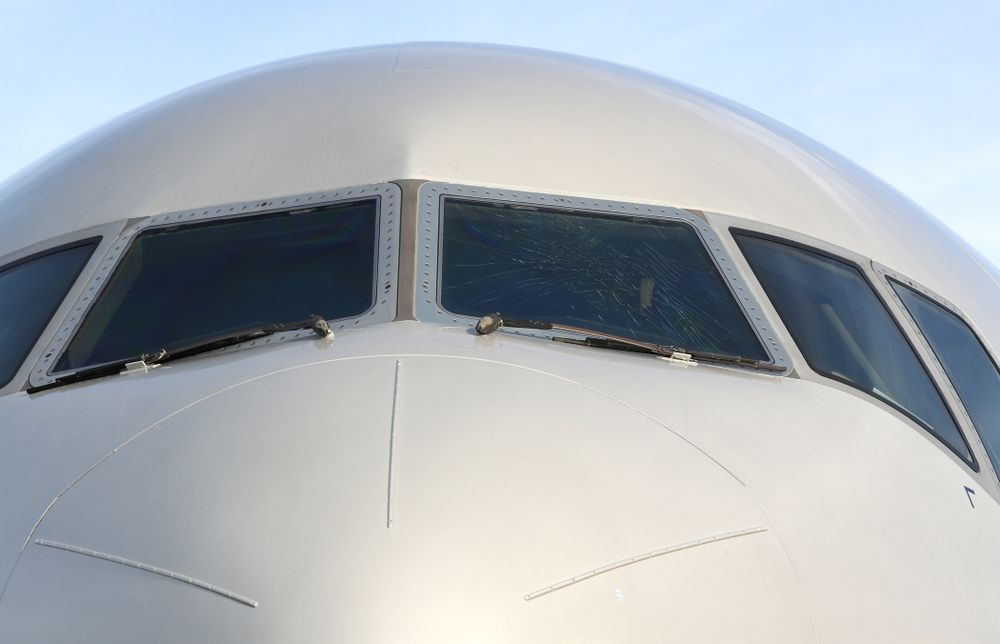 The outer layer of the front windscreen of the team plane is cracked Wednesday, December 26, 2018 as the Iowa Hawkeyes arrive in Tampa, Florida for the Outback Bowl. The flight crew scheduled to take the plane said the damage happened in flight and was due to fatigue from pressure changes in the air. (Brian Ray/hawkeyesports.com)