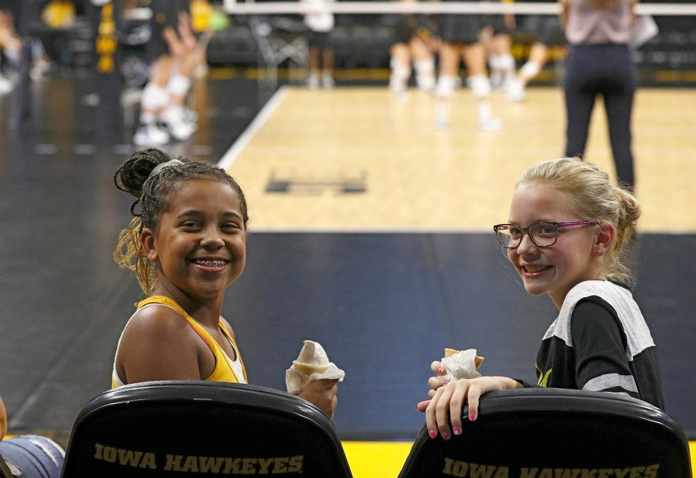 Two young fans eat ice cream cones before the Big Ten/Pac-12 Challenge match against Colorado at Carver-Hawkeye Arena in Iowa City on Friday, Sep 6, 2019. (Stephen Mally/hawkeyesports.com)