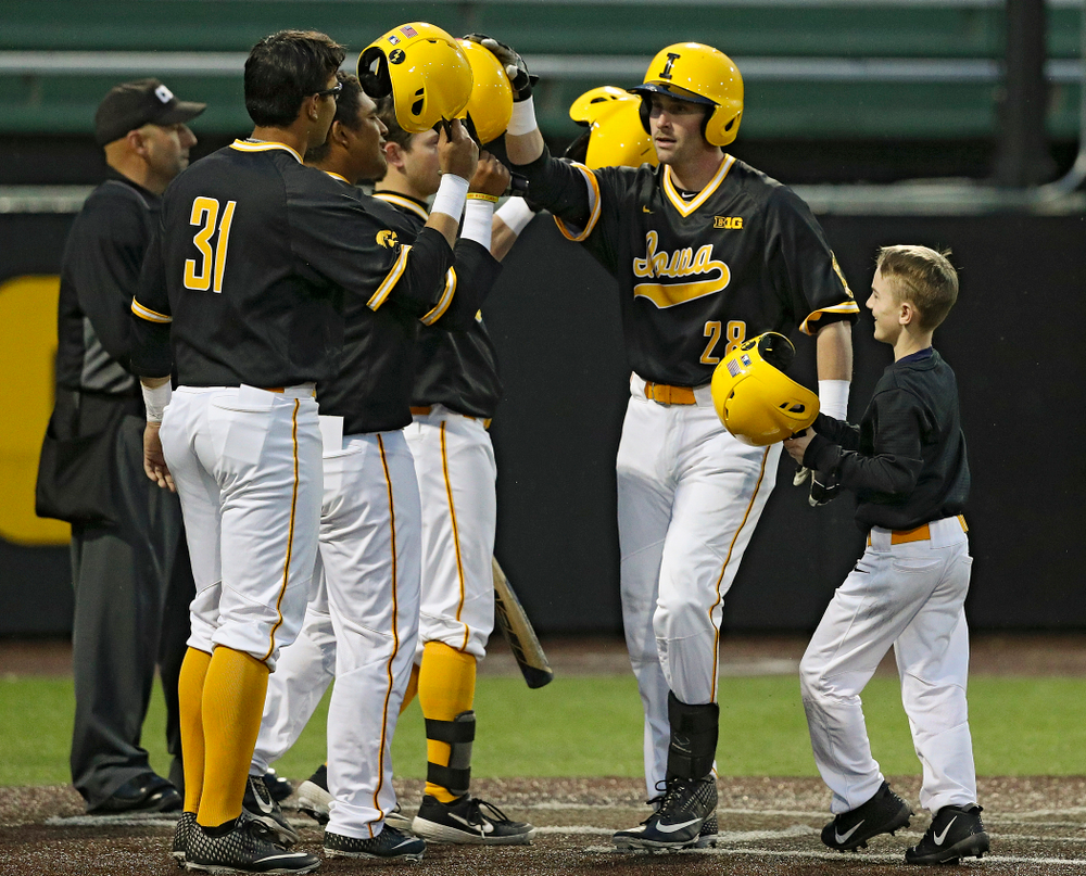 Iowa Hawkeyes left fielder Chris Whelan (28) is greeted at home after hitting a 3-run home run during the ninth inning of their game against Illinois State at Duane Banks Field in Iowa City on Wednesday, Apr. 3, 2019. (Stephen Mally/hawkeyesports.com)