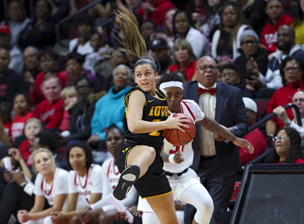 Iowa guard Gabbie Marshall (24) pulls in a ball during the third quarter of their game at the Rutgers Athletic Center in Piscataway, N.J. on Sunday, March 1, 2020. (Stephen Mally/hawkeyesports.com)