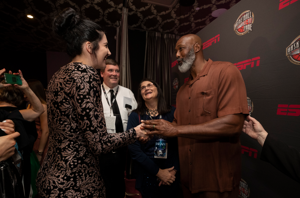 Iowa Hawkeyes forward Megan Gustafson (10) and her family with NBA great Karl Malone before the ESPN College Basketball Awards show Friday, April 12, 2019 at The Novo at LA Live.  (Brian Ray/hawkeyesports.com)