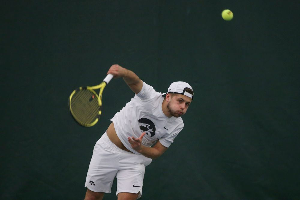 Iowa's Will Davies serves the ball during the Iowa men's tennis meet vs Nebraska on Sunday, March 1, 2020 at the Hawkeye Tennis and Recreation Complex. (Lily Smith/hawkeyesports.com)