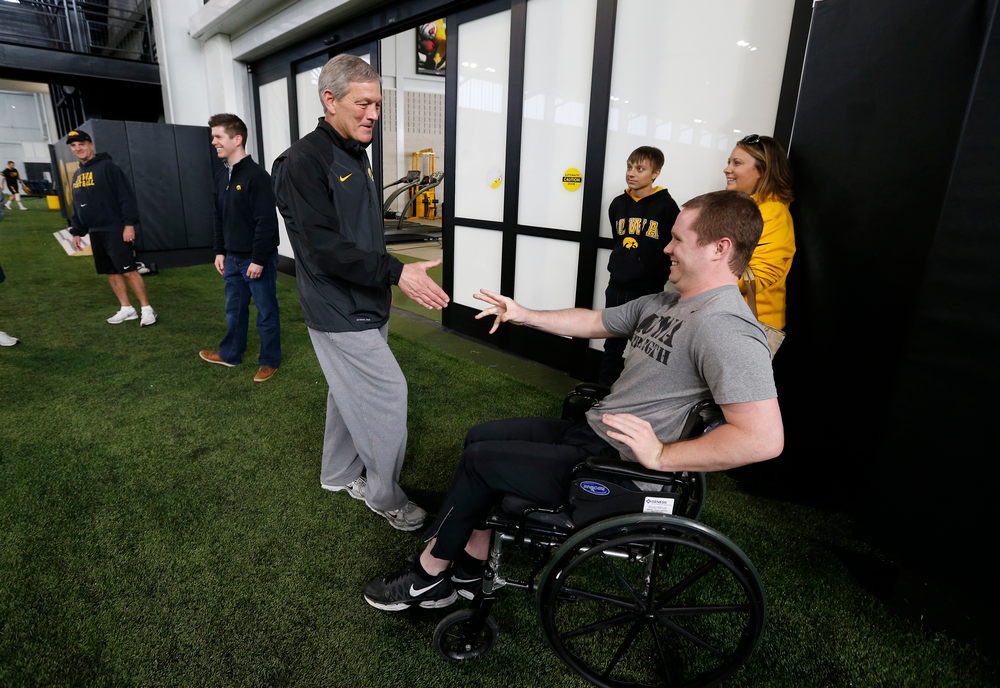 Brett Greenwood and Head Coach Kirk Ferentz
