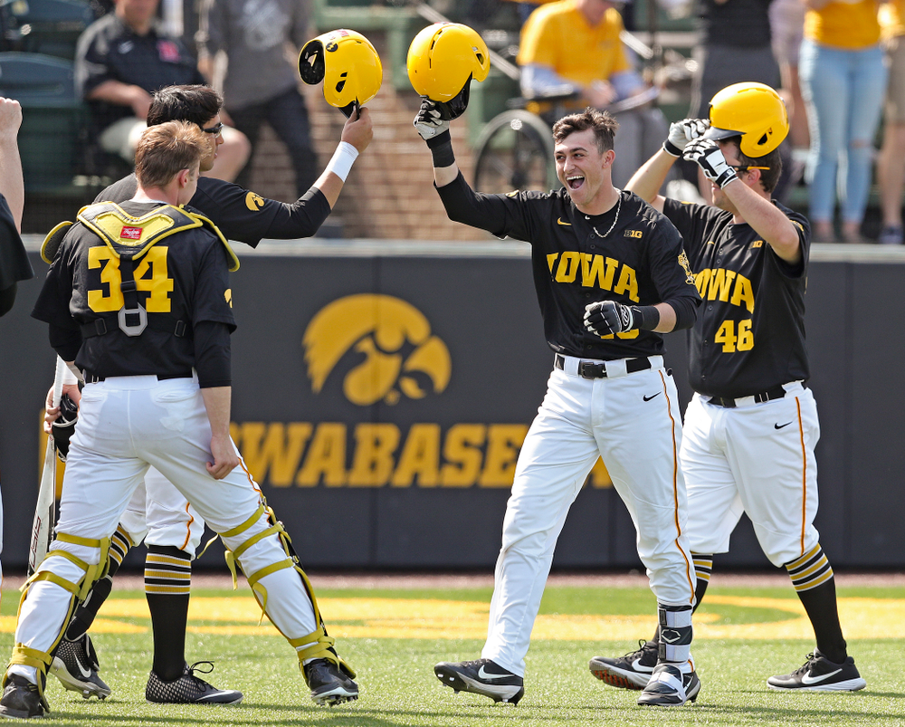 Iowa Hawkeyes shortstop Tanner Wetrich (16) celebrates after hitting a solo home run during the second inning of their game against Rutgers at Duane Banks Field in Iowa City on Saturday, Apr. 6, 2019. (Stephen Mally/hawkeyesports.com)