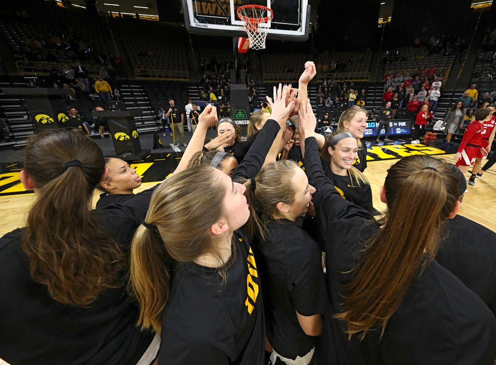 The Hawkeyes huddle before the game at Carver-Hawkeye Arena in Iowa City on Thursday, February 6, 2020. (Stephen Mally/hawkeyesports.com)