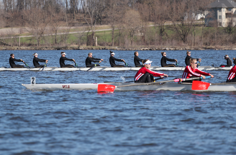 Iowa's Rachel Kram (from left), Lauren Collier, Noelle Ossenkop, Erika Davidson, Riley Seufert, Molly Rygh, Kirsten Jurgersen, Amelia Juhl, and Alexis Wolf during their I Novice 8 race against Wisconsin in their Big Ten Double Dual Rowing Regatta at Lake Macbride in Solon on Saturday, Apr. 13, 2019. (Stephen Mally/hawkeyesports.com)