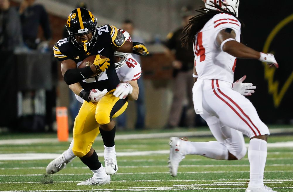 Iowa Hawkeyes running back Ivory Kelly-Martin (21) runs the ball during a game against Wisconsin at Kinnick Stadium on September 22, 2018. (Tork Mason/hawkeyesports.com)