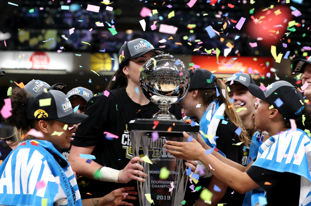 Iowa Hawkeyes forward Megan Gustafson (10) kisses the trophy as they celebrate their victory over the Maryland Terrapins in the Big Ten Championship Game Sunday, March 10, 2019 at Bankers Life Fieldhouse in Indianapolis, Ind. (Brian Ray/hawkeyesports.com)
