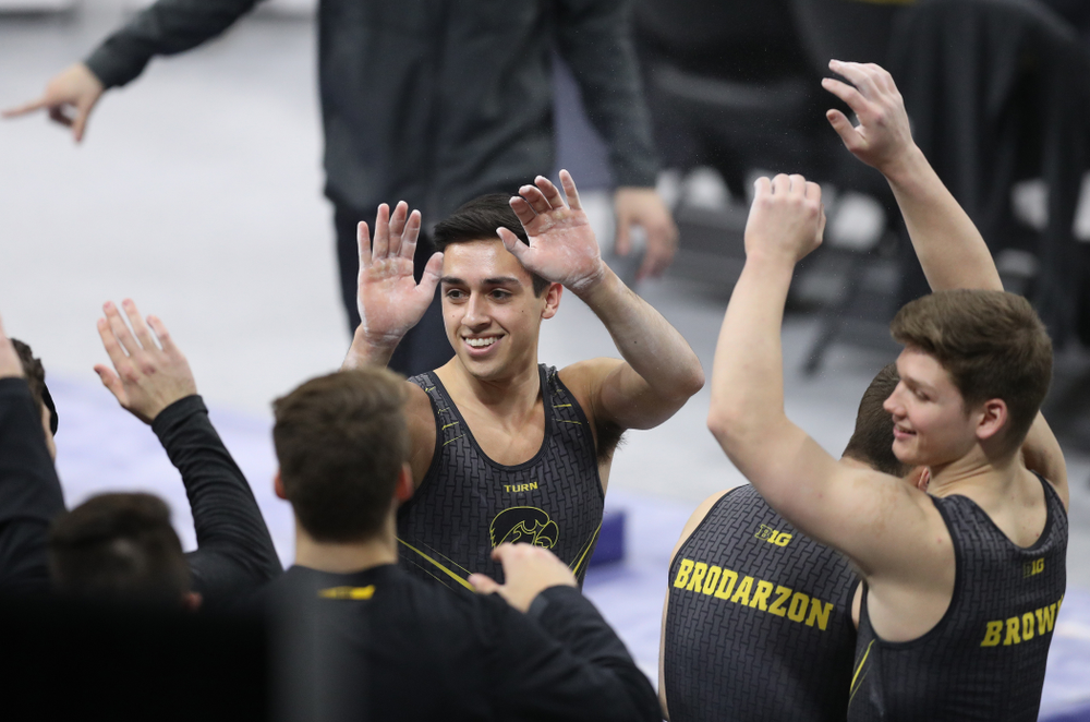 Iowa's Andrew Herrador competes on the parallel bars against Oklahoma Saturday, February 9, 2019 at Carver-Hawkeye Arena. (Brian Ray/hawkeyesports.com)
