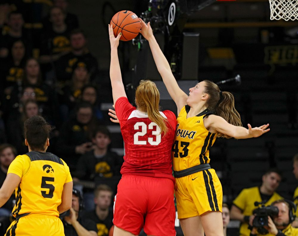 Iowa Hawkeyes forward Amanda Ollinger (43) blocks a shot by Ohio State Buckeyes forward Rebeka Mikulasikova (23) during the third quarter of their game at Carver-Hawkeye Arena in Iowa City on Thursday, January 23, 2020. (Stephen Mally/hawkeyesports.com)