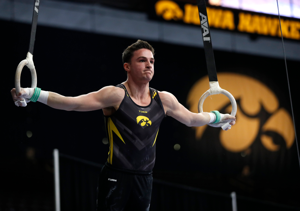 Jake Brodarzon competes on the rings against Minnesota and Air Force