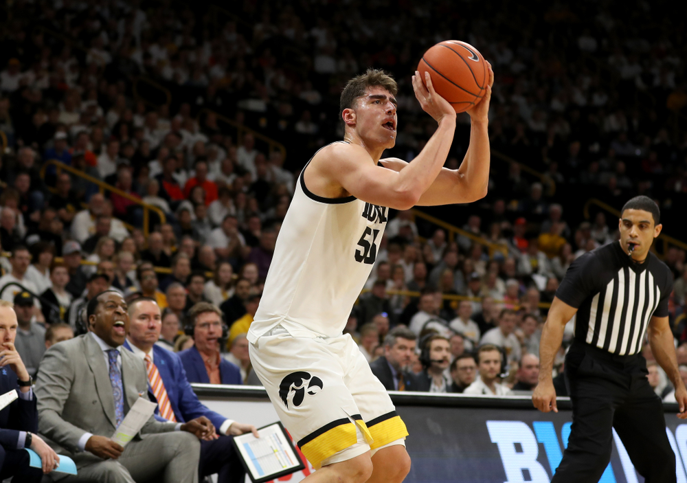 Iowa Hawkeyes forward Luka Garza (55) makes a three point basket against the Illinois Fighting Illini Sunday, February 2, 2020 at Carver-Hawkeye Arena. (Brian Ray/hawkeyesports.com)