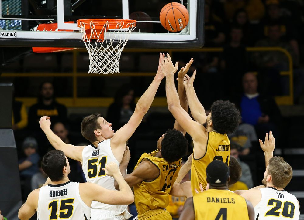 Iowa Hawkeyes forward Nicholas Baer (51) fights for a rebound during a game against Alabama State at Carver-Hawkeye Arena on November 21, 2018. (Tork Mason/hawkeyesports.com)