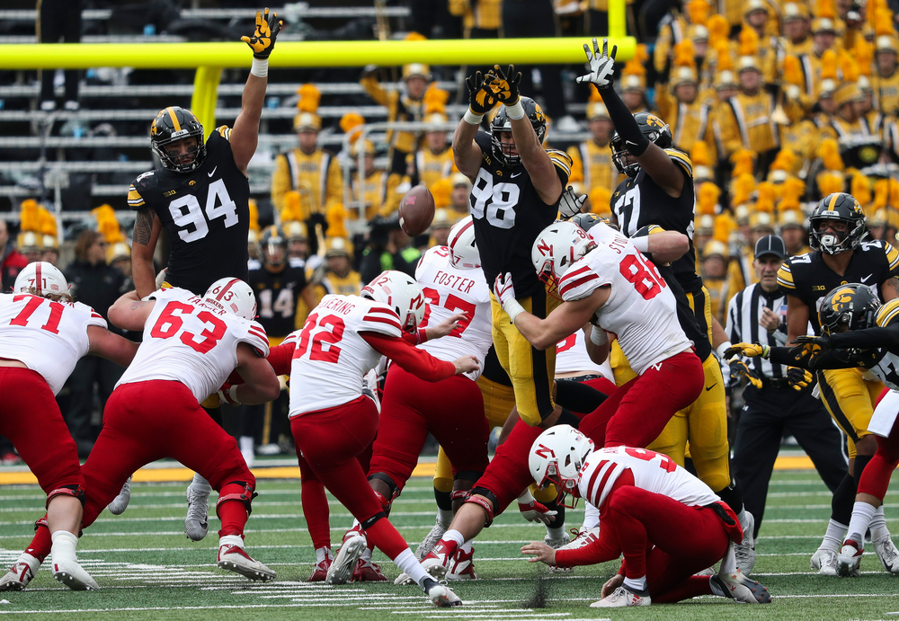 Iowa Hawkeyes defensive end A.J. Epenesa (94), Iowa Hawkeyes defensive end Anthony Nelson (98) and Iowa Hawkeyes defensive end Chauncey Golston (57) try to block a field goal at the end of the first half during a game against Nebraska at Kinnick Stadium on November 23, 2018. (Tork Mason/hawkeyesports.com)