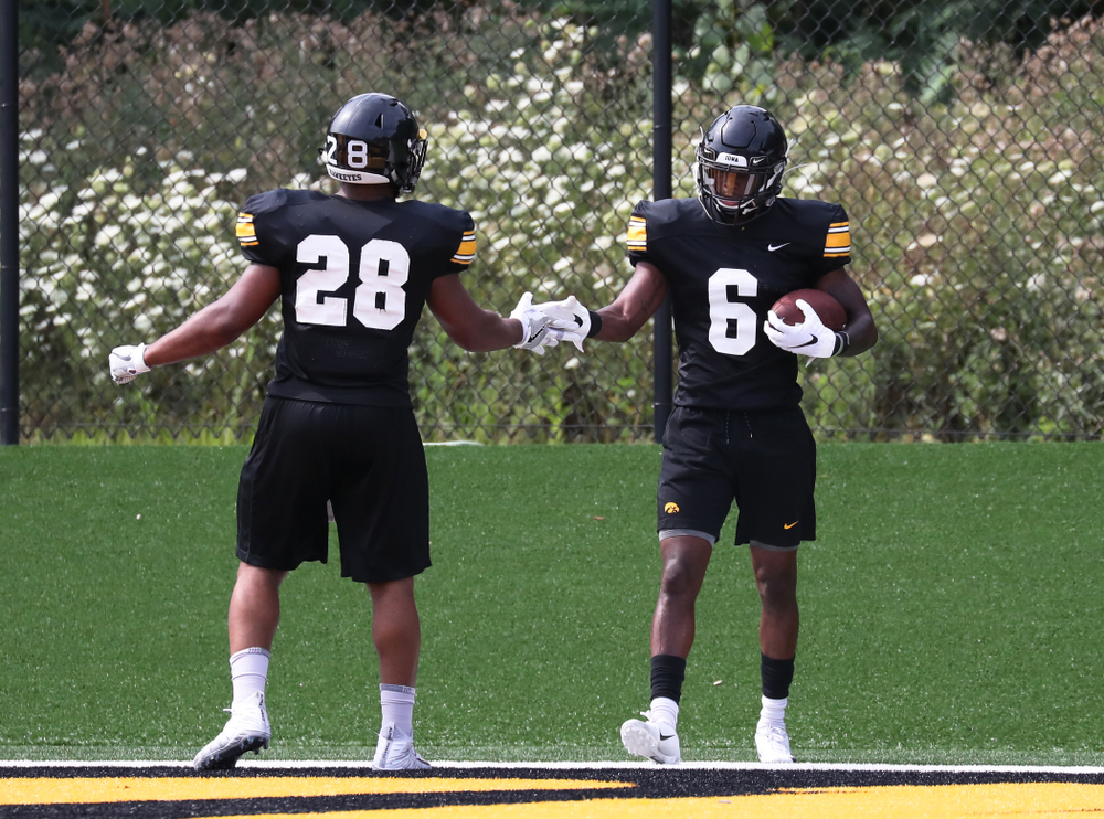 Iowa Hawkeyes running back Toren Young (28) and wide receiver Ihmir Smith-Marsette (6)