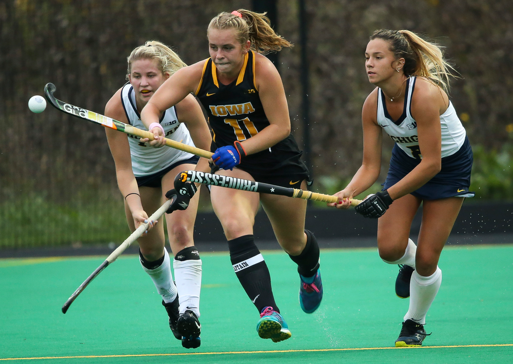Iowa Hawkeyes midfielder Katie Birch (11) fights for possession during a game against Michigan at Grant Field on October 5, 2018. (Tork Mason/hawkeyesports.com)
