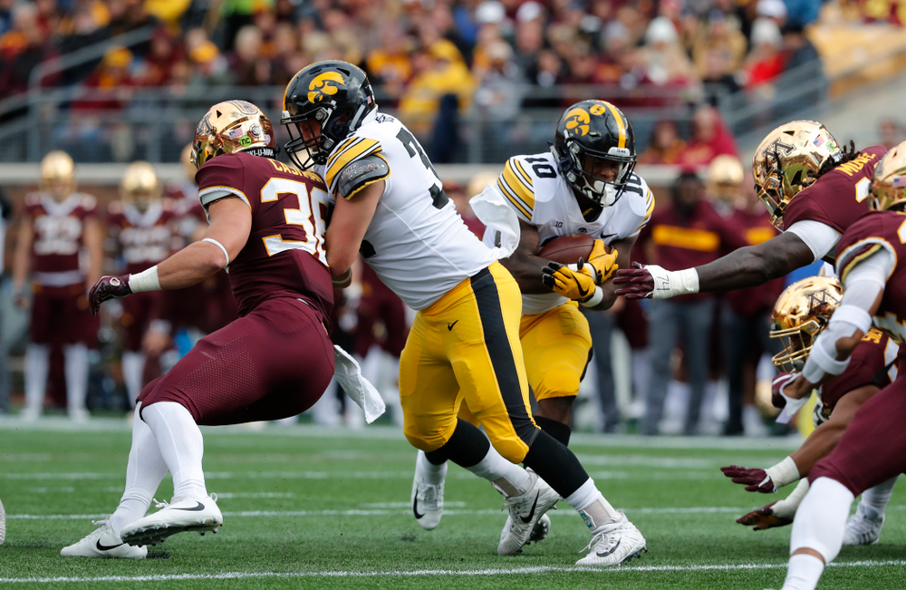 Iowa Hawkeyes fullback Brady Ross (36) blocks for running back Mekhi Sargent (10) against the Minnesota Golden Gophers Saturday, October 6, 2018 at TCF Bank Stadium. (Brian Ray/hawkeyesports.com)