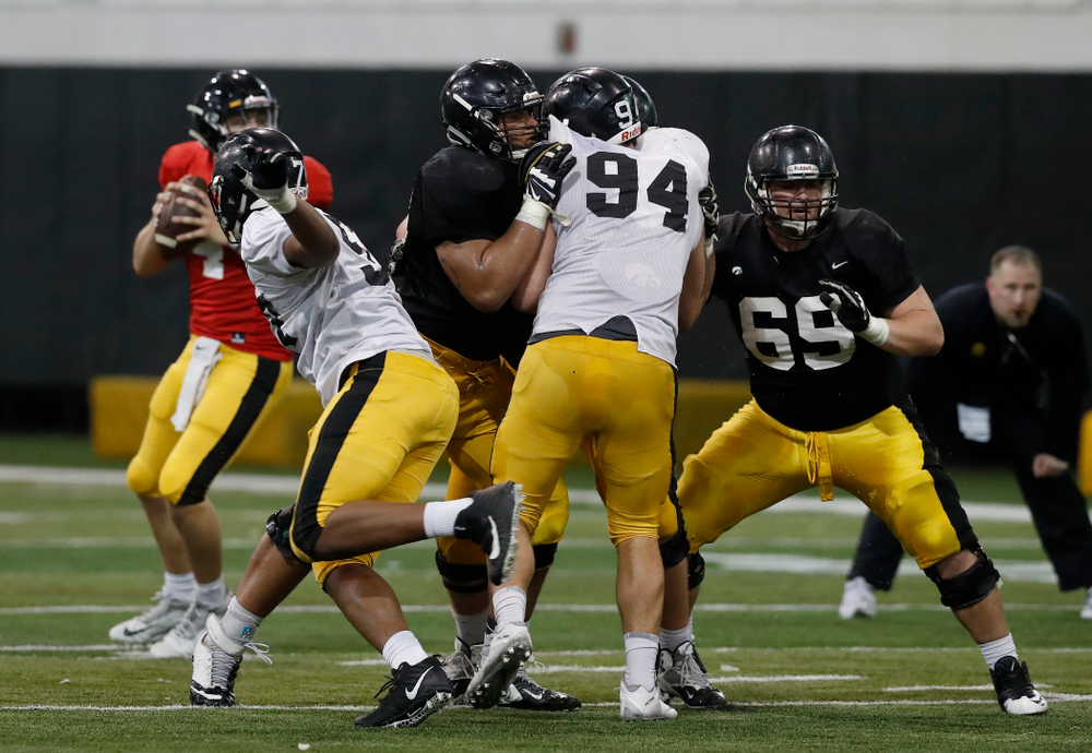 Iowa Hawkeyes offensive lineman Tristan Wirfs (74), offensive lineman Keegan Render (69), and defensive end A.J. Epenesa (94) during spring practice No. 13 Wednesday, April 18, 2018 at the Hansen Football Performance Center. (Brian Ray/hawkeyesports.com)