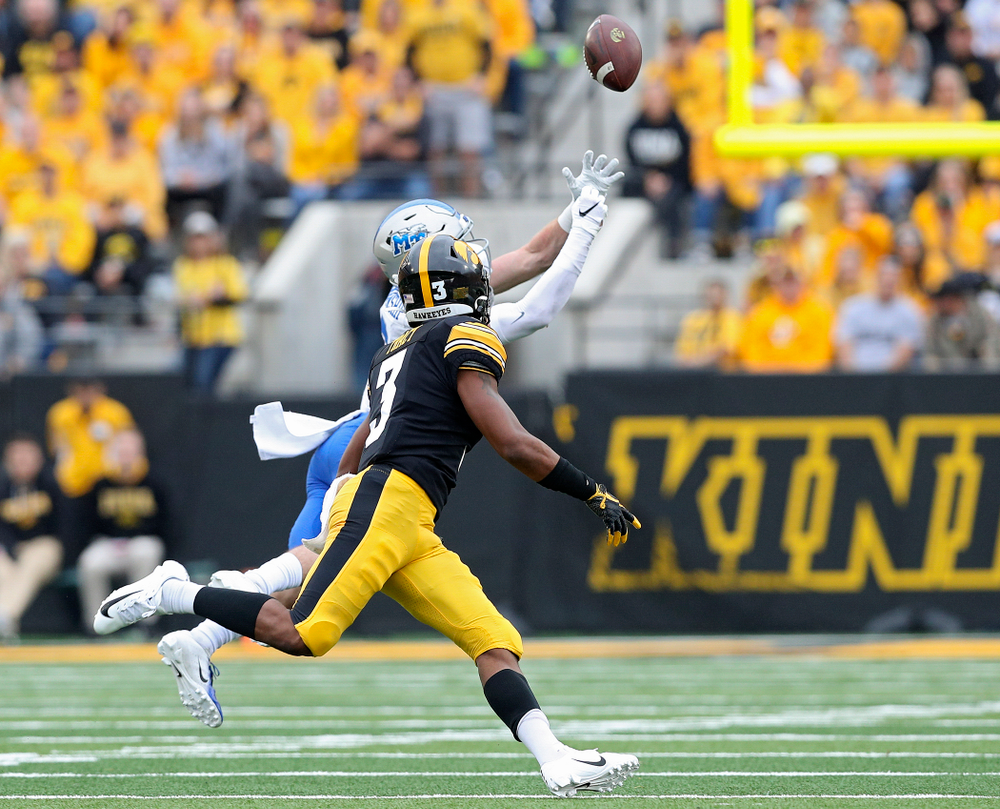 Iowa Hawkeyes wide receiver Tyrone Tracy Jr. (3) pulls in a pass after it bounced off the hands of Middle Tennessee State free safety Reed Blankenship (12) during the first quarter of their game at Kinnick Stadium in Iowa City on Saturday, Sep 28, 2019. (Stephen Mally/hawkeyesports.com)