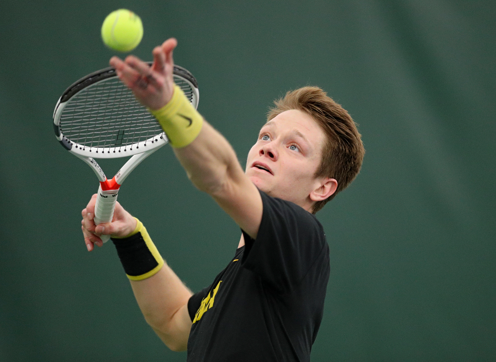 Iowa's Jason Kerst serves during his match against Marquette at the Hawkeye Tennis and Recreation Complex in Iowa City on Saturday, January 25, 2020. (Stephen Mally/hawkeyesports.com)
