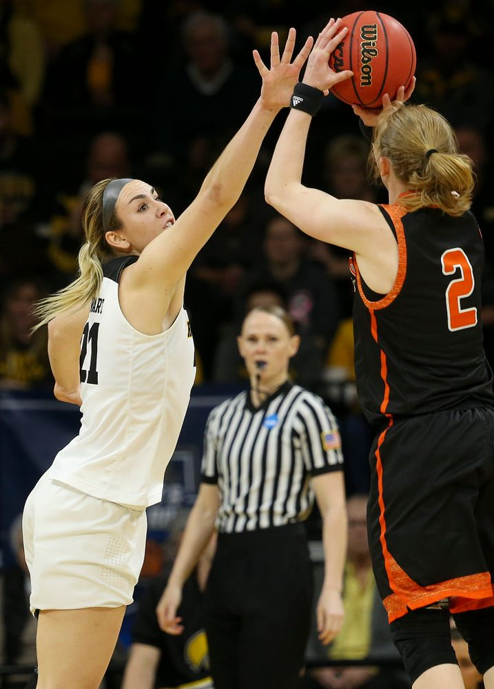 Iowa Hawkeyes forward Hannah Stewart (21) tries to block a shot by Mercer Bears forward Amanda Thompson (2) during the first round of the 2019 NCAA Women's Basketball Tournament at Carver Hawkeye Arena in Iowa City on Friday, Mar. 22, 2019. (Stephen Mally for hawkeyesports.com)