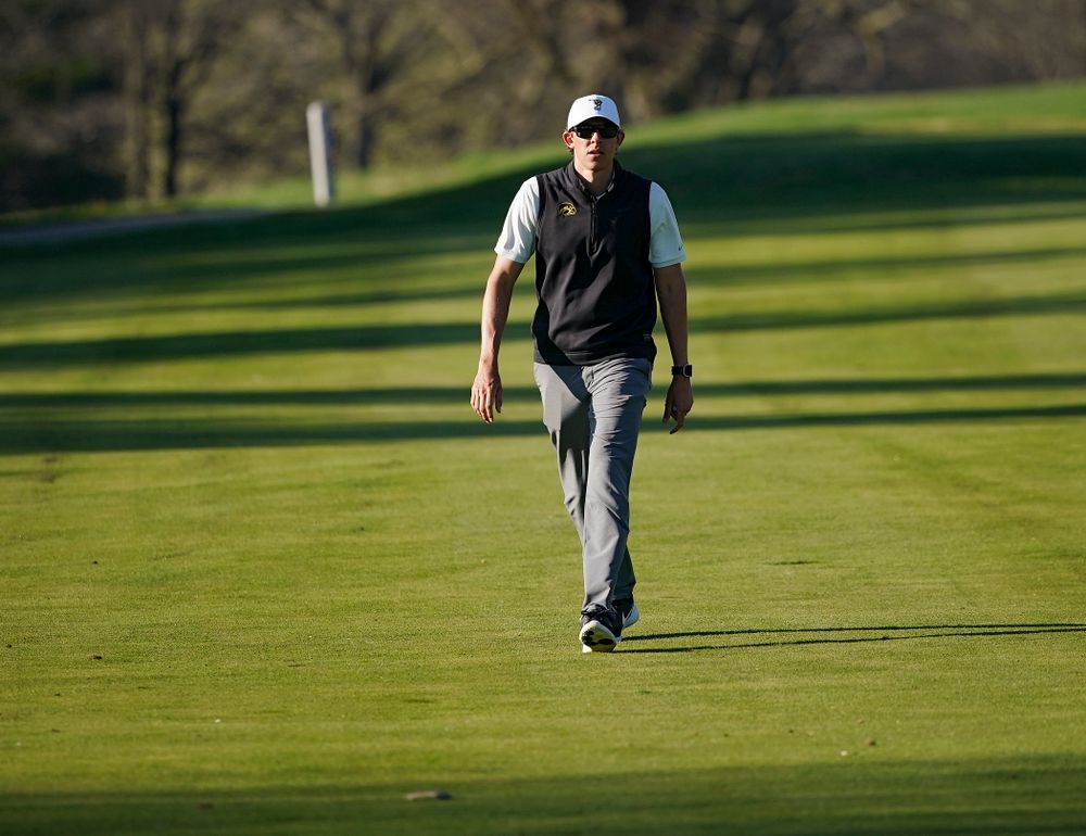 Iowa assistant coach Charlie Hoyle walks down the fairway during the second round of the Hawkeye Invitational at Finkbine Golf Course in Iowa City on Saturday, Apr. 20, 2019. (Stephen Mally/hawkeyesports.com)