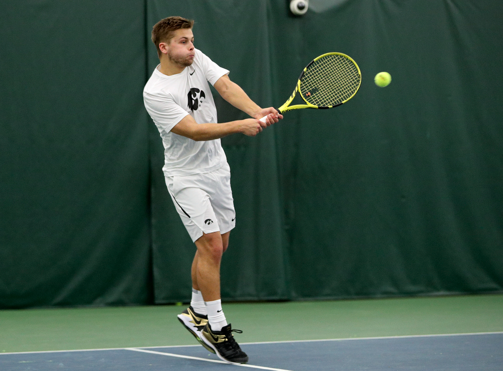 Iowa's Will Davies returns a shot during his doubles match at the Hawkeye Tennis and Recreation Complex in Iowa City on Sunday, February 16, 2020. (Stephen Mally/hawkeyesports.com)