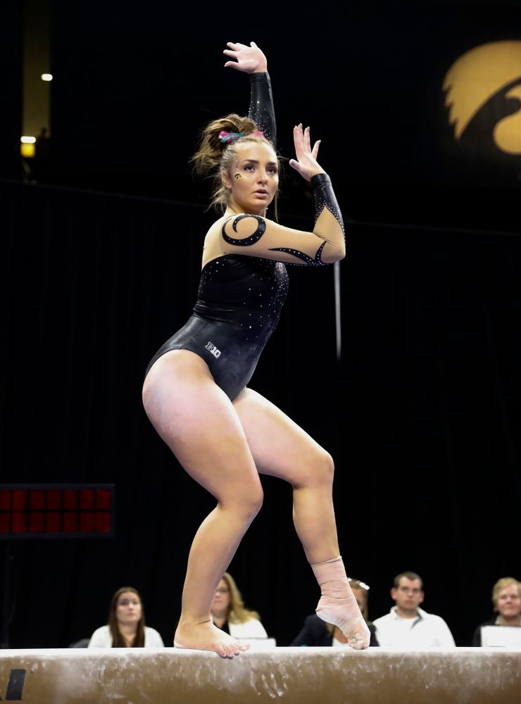 Iowa's Bre Fitzke competes on the beam