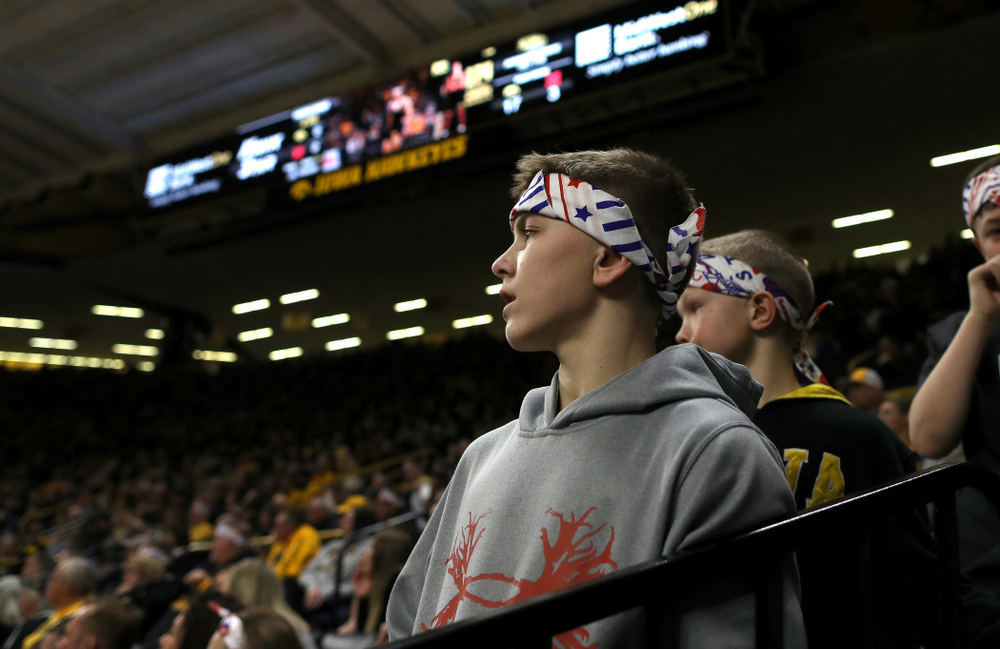A fan wears a Sorensen Strong headband as he watches Iowa's Michael Kemerer wrestle Nebraska's Mickey Labriola at 174 pounds Saturday, January 18, 2020 at Carver-Hawkeye Arena. Kemerer won the match 3-1. (Brian Ray/hawkeyesports.com)