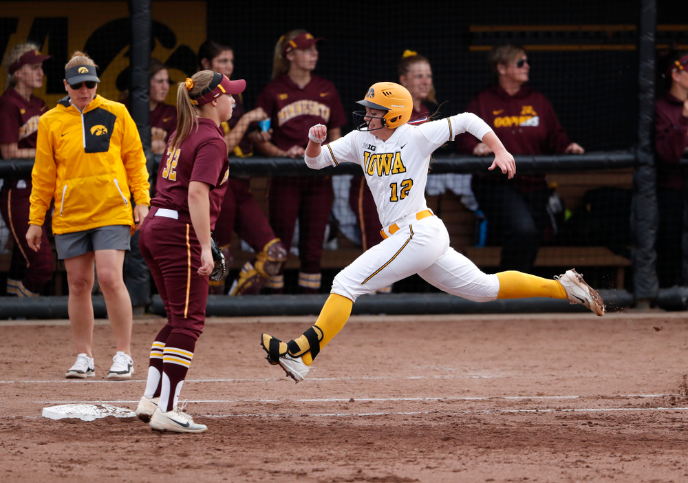 Iowa Hawkeyes catcher Angela Schmiederer (12) against the Minnesota Golden Gophers  Thursday, April 12, 2018 at Bob Pearl Field. (Brian Ray/hawkeyesports.com)