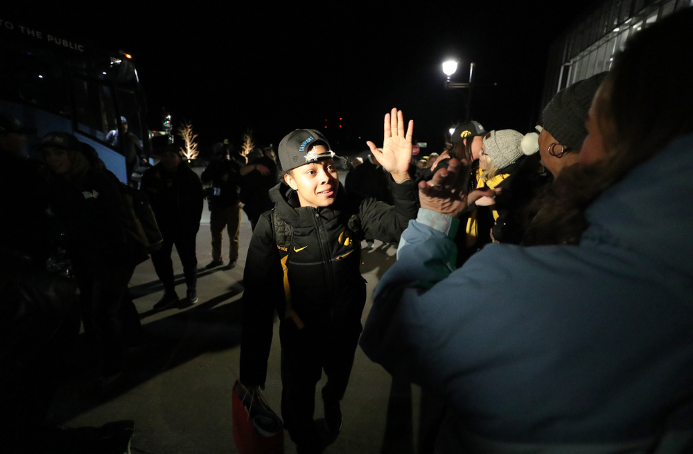 Iowa Hawkeyes guard Tania Davis (11) celebrates with fans as they arrive back in Coralville after defeating the Maryland Terrapins in the Big Ten Championship Game Sunday, March 10, 2019 in Indianapolis, Ind. (Brian Ray/hawkeyesports.com)