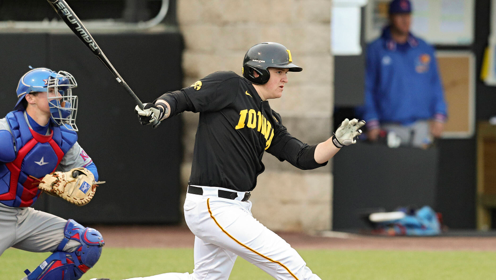 Iowa first baseman Peyton Williams (45) drives in a run with a hit during the eighth inning of their college baseball game at Duane Banks Field in Iowa City on Tuesday, March 10, 2020. (Stephen Mally/hawkeyesports.com)