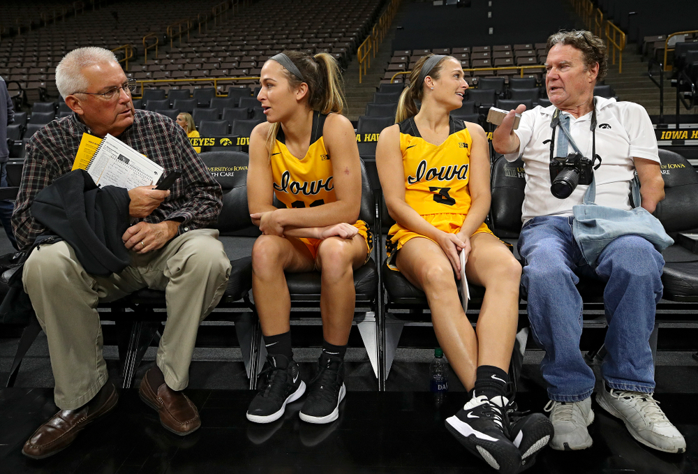 Iowa guard Megan Meyer (11) and guard Makenzie Meyer (3) answer questions during Iowa Women's Basketball Media Day at Carver-Hawkeye Arena in Iowa City on Thursday, Oct 24, 2019. (Stephen Mally/hawkeyesports.com)