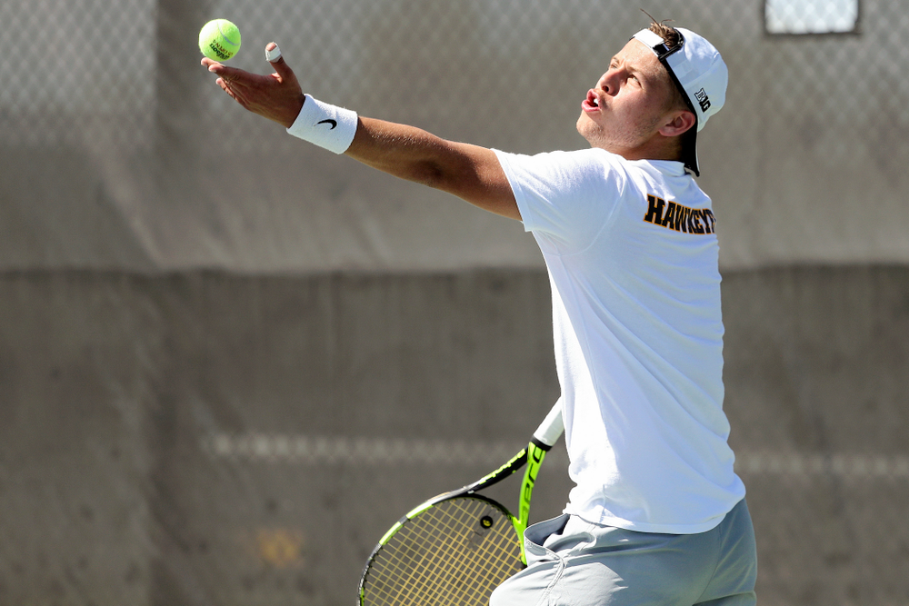 Iowa's Will Davies serves during his match against Michigan at the Hawkeye Tennis and Recreation Complex in Iowa City on Sunday, Apr. 21, 2019. (Stephen Mally/hawkeyesports.com)