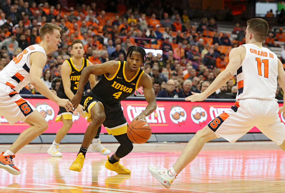 Iowa Hawkeyes guard Bakari Evelyn (4) drives with the ball during the first half of their ACC/Big Ten Challenge game at the Carrier Dome in Syracuse, N.Y. on Tuesday, Dec 3, 2019. (Stephen Mally/hawkeyesports.com)