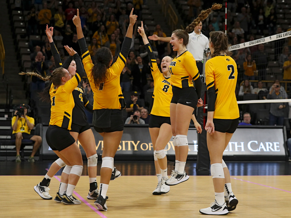Iowa's Joslyn Boyer (1), Halle Johnston (4), Brie Orr (7), Kyndra Hansen (8), Blythe Rients (11), and Courtney Buzzerio (2) celebrate a score during their match at Carver-Hawkeye Arena in Iowa City on Sunday, Oct 20, 2019. (Stephen Mally/hawkeyesports.com)