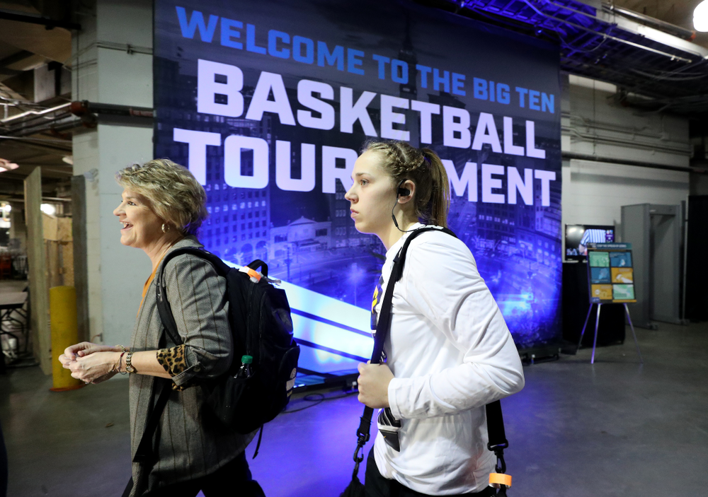 Iowa Hawkeyes head coach Lisa Bluder and guard Kathleen Doyle (22) arrive for their game against Ohio State in the quarterfinals of the Big Ten Basketball Tournament Friday, March 6, 2020 at Bankers Life Fieldhouse in Indianapolis. (Brian Ray/hawkeyesports.com)